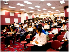 Students attending class in a fully equip APU classroom